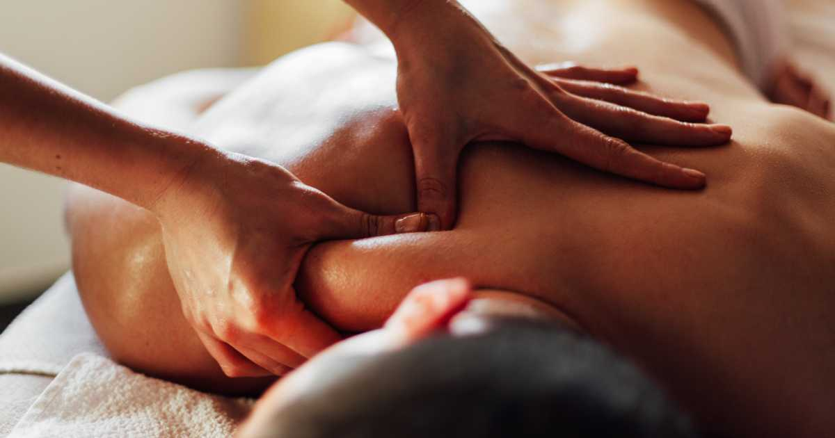 man receiving massage from massage therapy